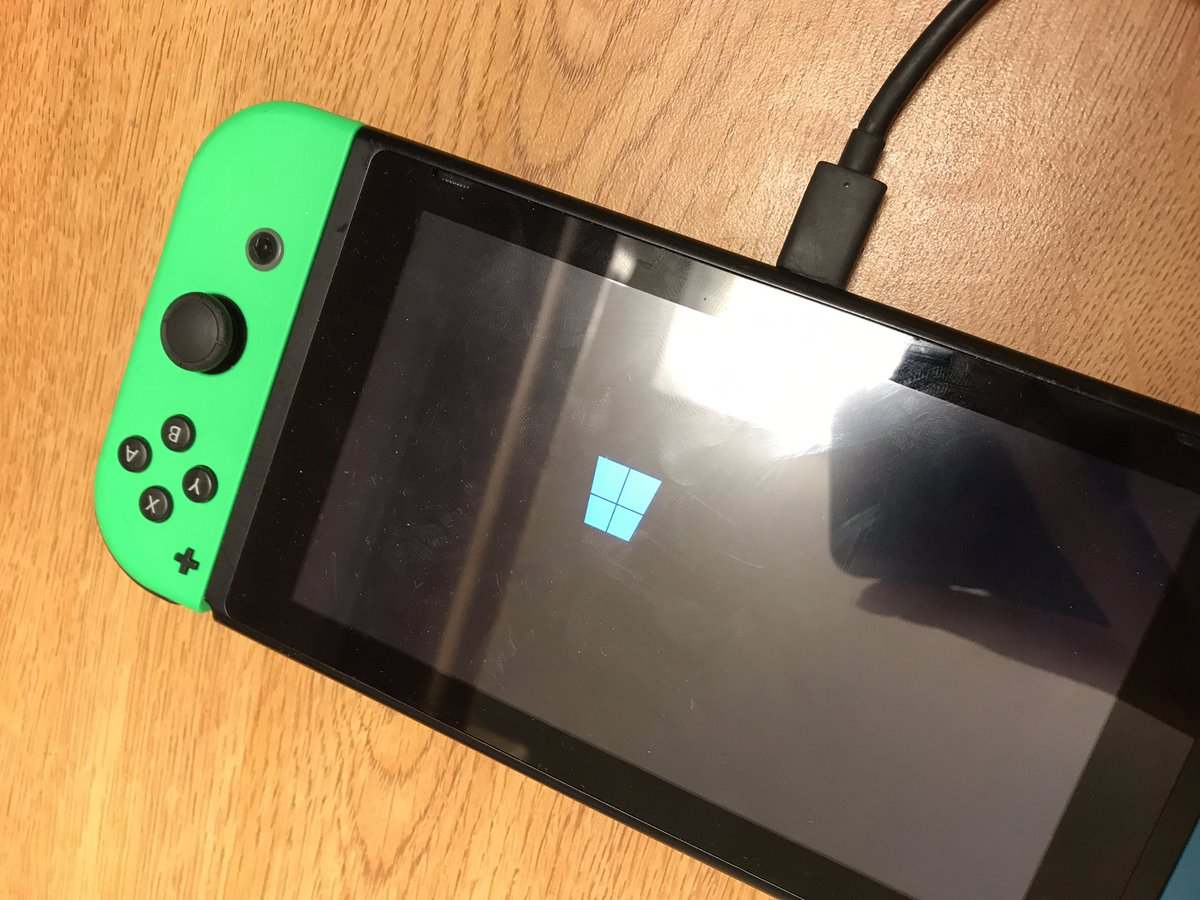 "A Nintendo Switch showing the ""Windows Blue Logo"""